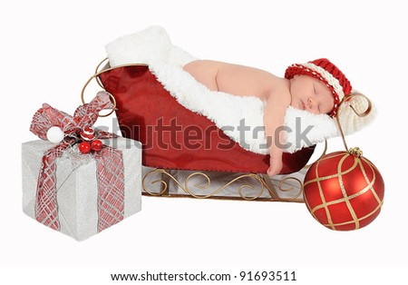 sweet newborn asleep in santa sleigh. isolated on white - stock photo