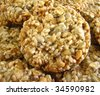 Sweet oatmeal cookies with crunchy toasted sunflower seeds - stock photo