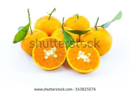 Sweet orange fruit with leaves on white background. - stock photo