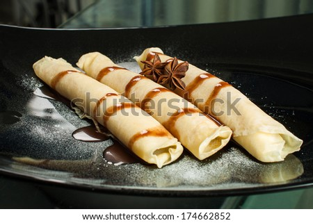 Sweet pancakes with cream - stock photo