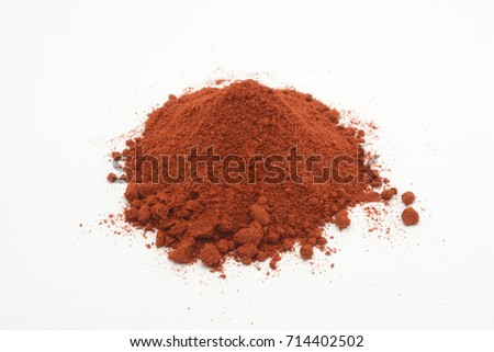 Sweet paprika on white background, red color