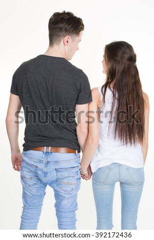 Sweet partners hold each others' hands while standing isolated