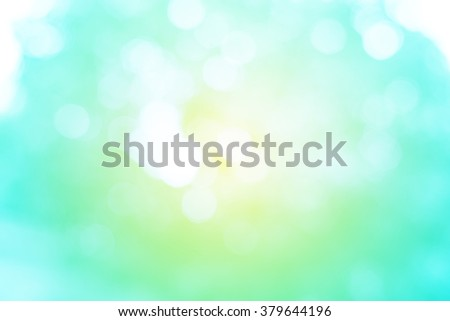 Sweet Pastel Blue Mint and Yellow Abstract Bokeh Background - stock photo
