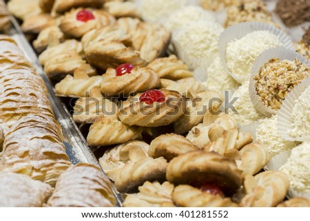sweet pastry biscuits decorated with cherry - stock photo