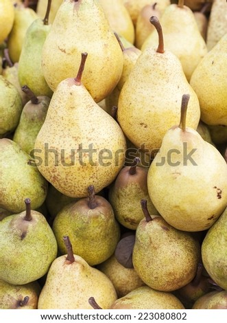 Sweet pears for sale in big market - stock photo