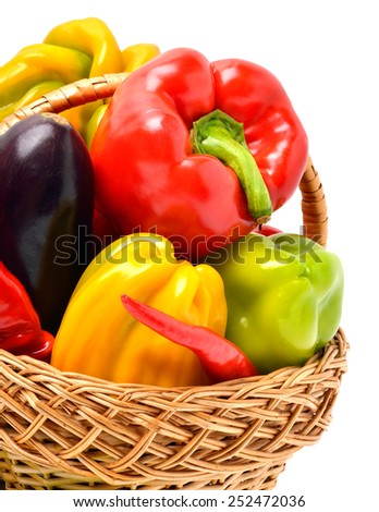 Sweet pepper, aubergine, chili pepper in the basket isolated on white - stock photo