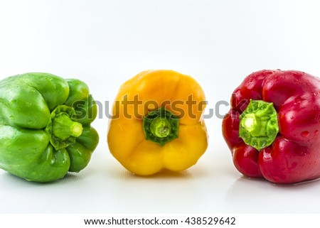 Sweet pepper on a white background./ Three colorful fresh yellow, red, green sweet pepper.