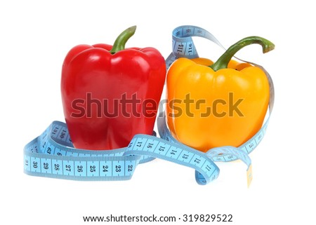 Sweet peppers with a blue measuring tape. - stock photo