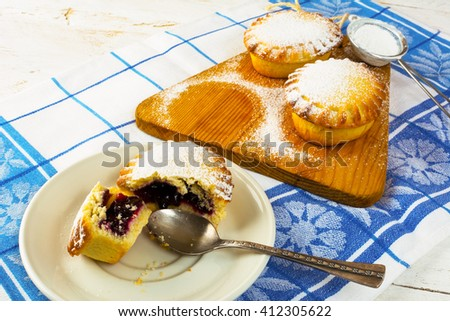 Sweet pie on the white plate. Sweet dessert. Sweet pastry. Small pie. Pie. Jam pie - stock photo