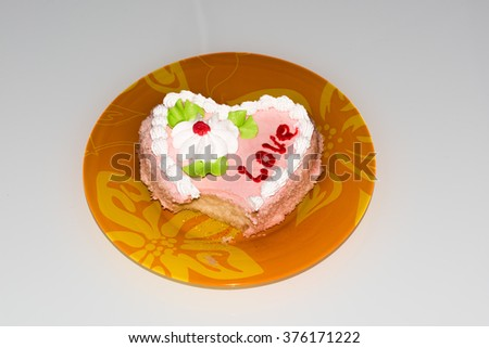 sweet piece of cake for loved ones and bitten by one - stock photo