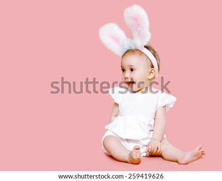 Sweet pink cute baby in costume easter bunny with fluffy ears - stock photo