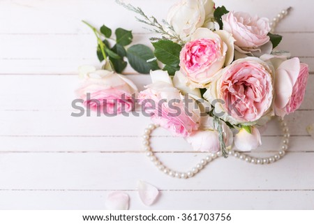 Sweet pink roses flowers   on white painted wooden background. Selective focus. Place for text. - stock photo