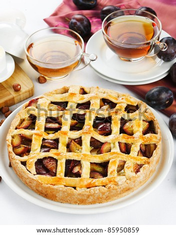 sweet plum pie with tea for lunch - stock photo