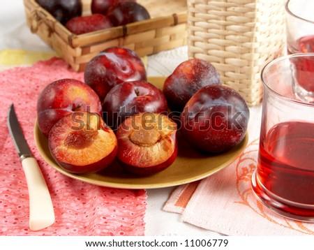 sweet plum with juice - stock photo