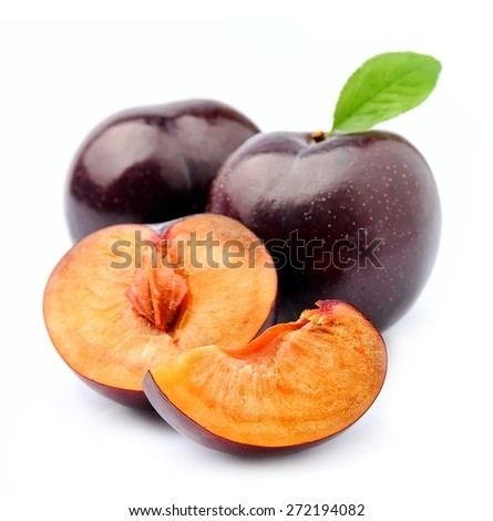 Sweet plums close up on white. - stock photo