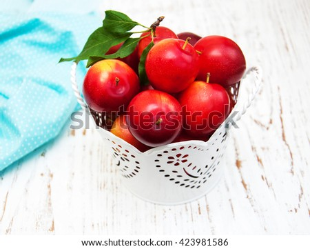 sweet plums on a old wooden background