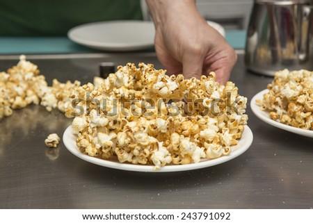 sweet pop corn on white plate - stock photo