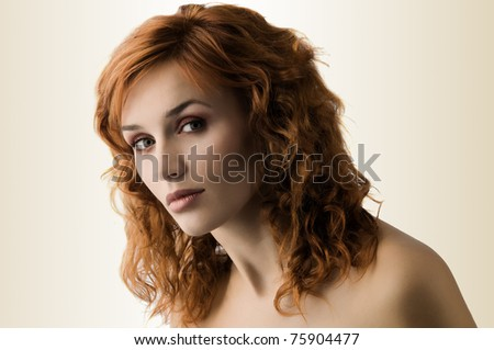 sweet portrait of cute red haired young woman with great makeup