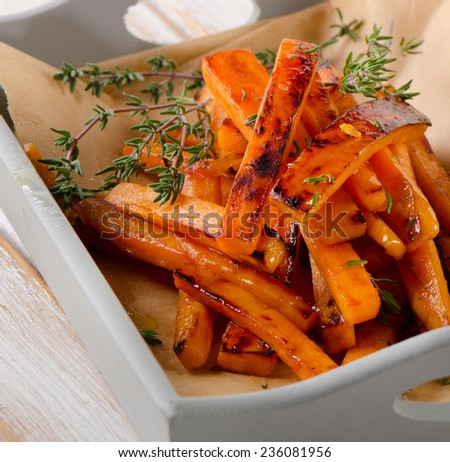 sweet potato fries with  herbs . Selective focus