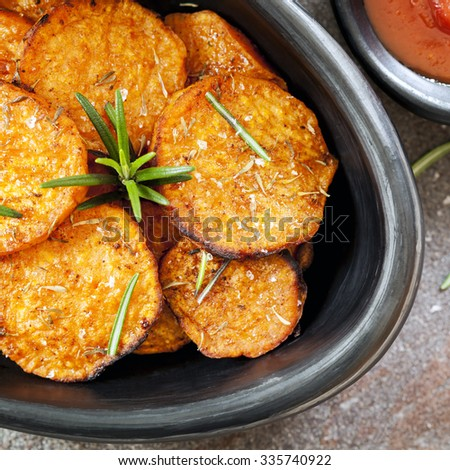 Sweet potato fries with rosemary and ketchup.  Overhead view. - stock photo