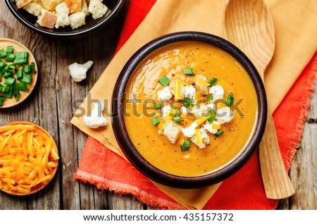sweet potatoes cauliflower soup on a dark wood background. toning. selective focus - stock photo