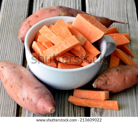Sweet potatoes ripe juicy beautiful on a wooden table. - stock photo