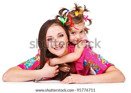 Sweet preschool girl embracing mother - stock photo