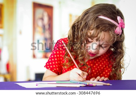 Sweet preschooler creative girl using colored pencils, drawing - stock photo