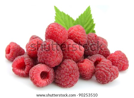 Sweet raspberry with leafs on white - stock photo
