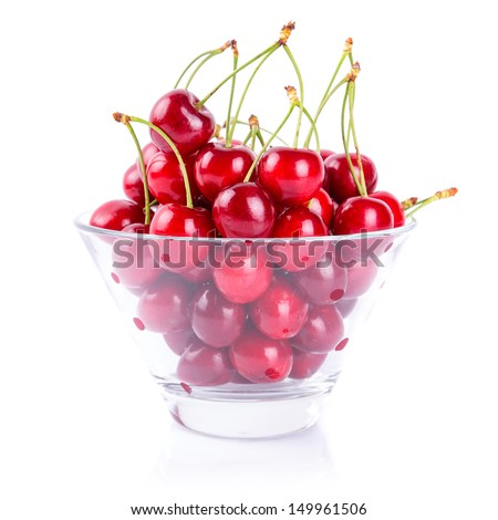 Sweet red cherries in the bowl over white - stock photo