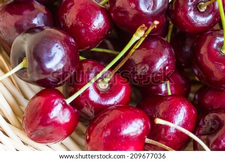 Sweet red cherries on a woven basket
