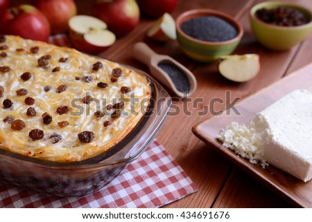 Sweet roasted pasta with poppy seeds, apples and curd cheese - stock photo