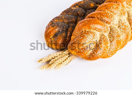 Sweet roll with poppy and sesame, isolated on white