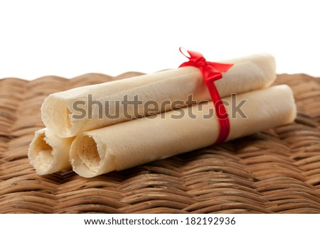 sweet rolled wafers with red ribbon