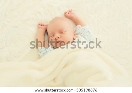 Sweet sleep infant lying on the bed at home - stock photo
