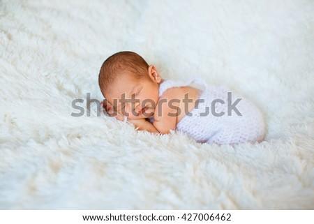 Sweet sleep of the small beautiful baby - stock photo