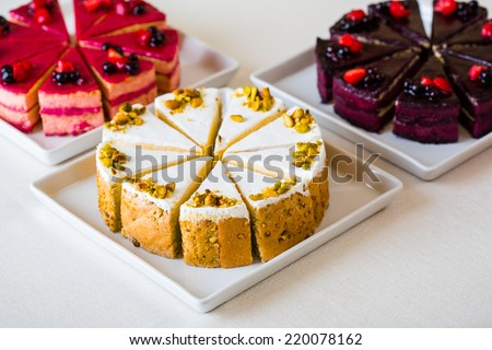 Sweet sliced cakes at white plate - stock photo
