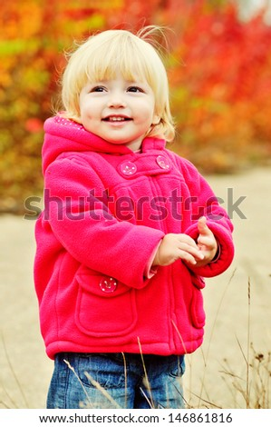 sweet smiling toddler in fall time - stock photo
