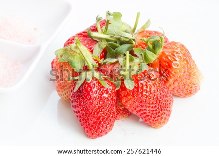 Sweet strawberry and plum powder for diet and high vitamin C - stock photo