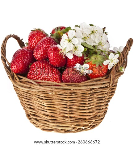 Sweet strawberry with flowers in basket isolated on white background - stock photo