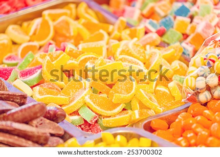Sweet Sugar Candies on a Street Market Shop Table, Selective focus with shallow depth of field. - stock photo