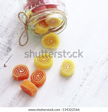 Sweet sugar candies on white wooden background - stock photo