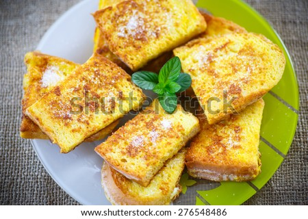 sweet toast fried egg sprinkled with powdered sugar - stock photo