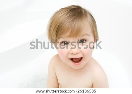 sweet toddler baby girl in bath - stock photo