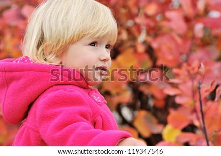 sweet toddler girl looking ahead - stock photo