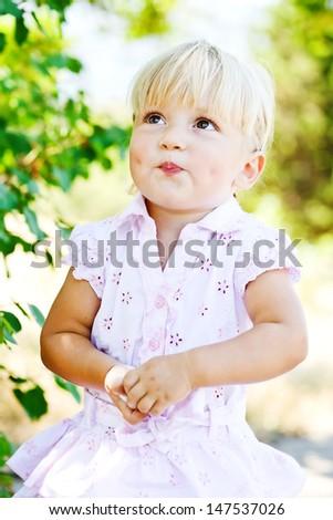sweet toddler girl wearing pink dress - stock photo