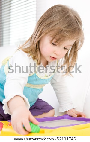 sweet toddler little girl drawing