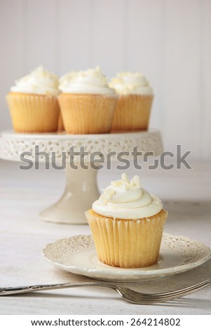 Sweet vanilla cupcakes ready to eat - stock photo