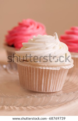 sweet vanilla pink and white cupcakes - stock photo