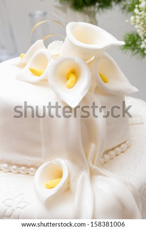 Sweet White Wedding Cake Decorated With Flowers - stock photo